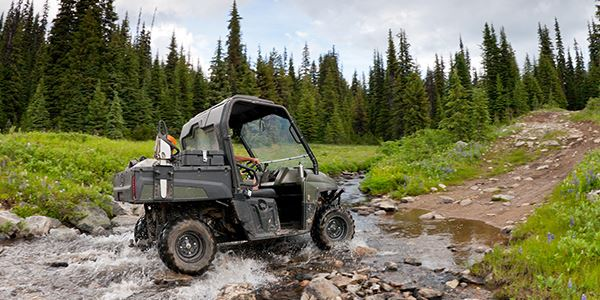 Small Off-Road Vehicle Crossing a Stream