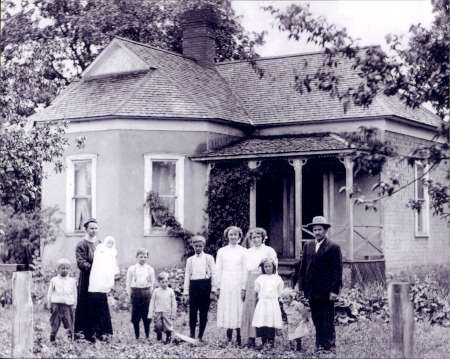Historical Photo of Family in Front of House