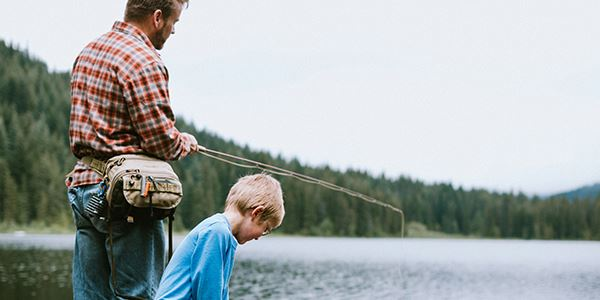 Man and Boy Fishing at a Lake